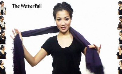 asian woman tying a scarf