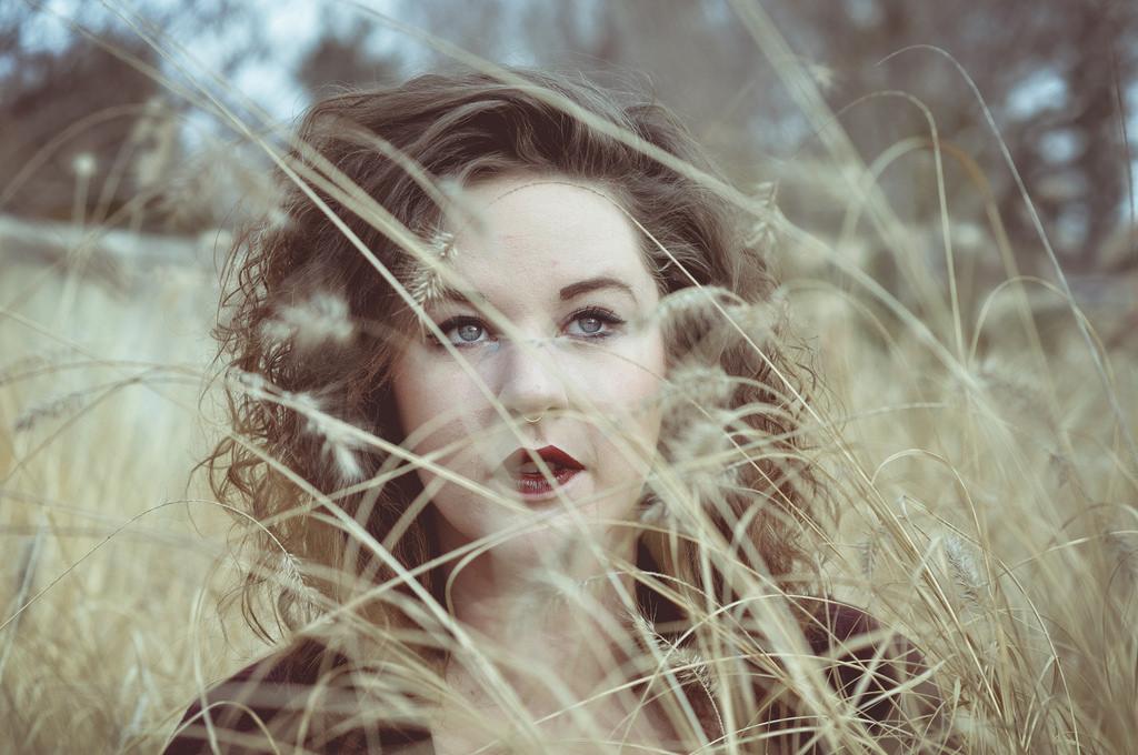 woman standing in field of wheat