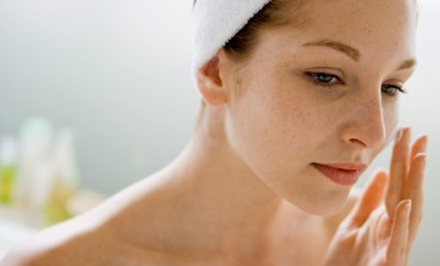 beautiful woman cleansing face