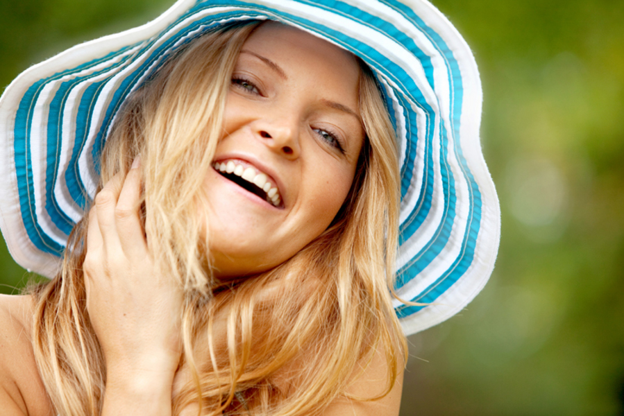 blonde woman with a summer hat