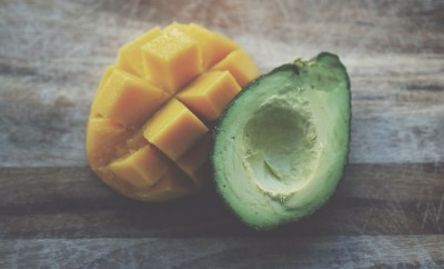 sliced avocado and mango on wood table