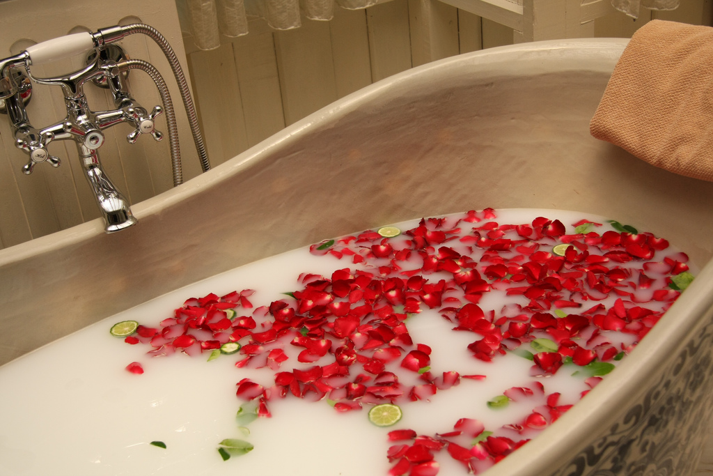 soaking in a body soak bath tub with rose petals