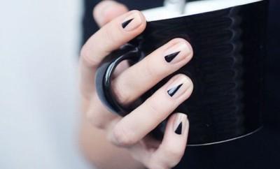 black nail art manicure with black coffee mug
