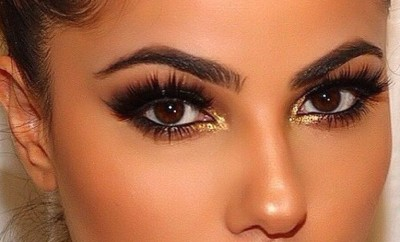 bold bright makeup with gold sparkle