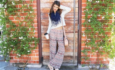 brunette woman with bohemian pants scarf and latte