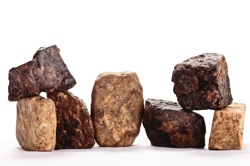 bars of African black soap on white background