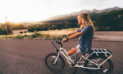 blonde girl on bike in California hills