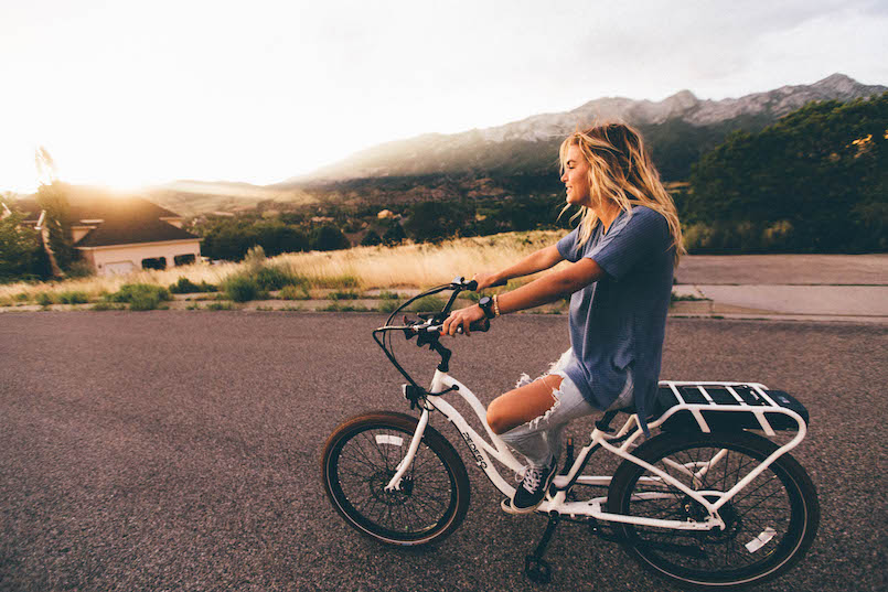 blonde girl on bike in California hills