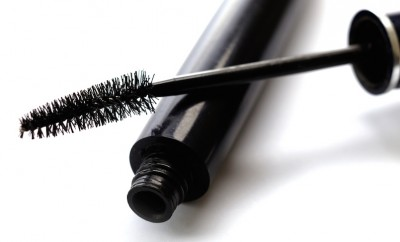black mascara brush on white background
