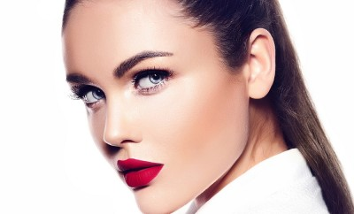 High fashion look.glamor closeup portrait of beautiful sexy stylish brunette business young woman model with bright makeup with red lips