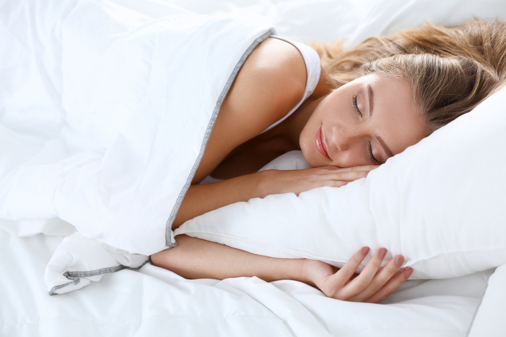 Beautiful girl sleeps in the bedroom, how to fall asleep