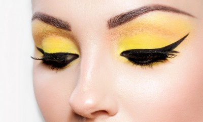 Close-up portrait of a young woman. Beautiful cat-eyeliner makeup.