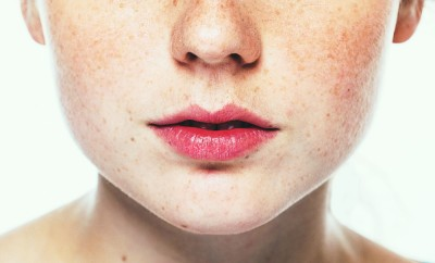Lips and nose Woman freckle happy young beautiful studio portrait with healthy skin