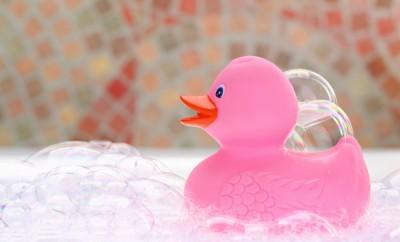 Pink rubber duck in bath foam