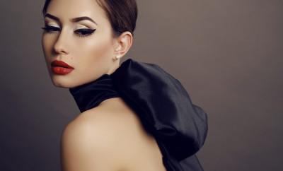 fashion studio photo of beautiful sensual woman with dark hair and bright makeup,wearing fashion dress