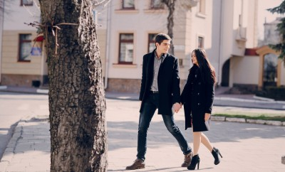 loving couple walking city