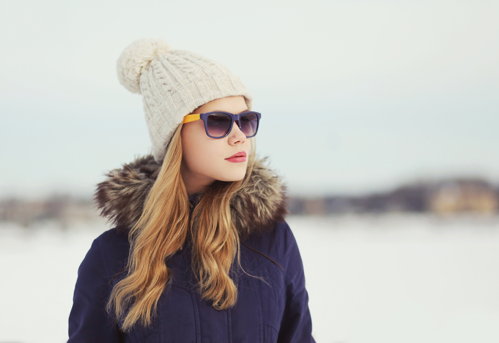 Portrait of beautiful woman outdoors in winter day
