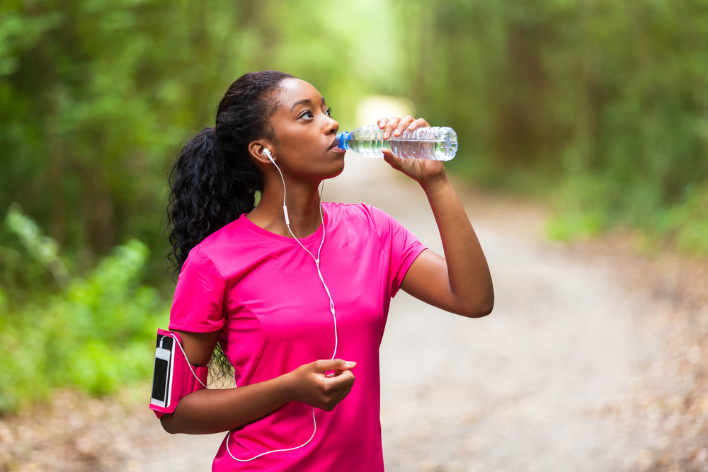 African american woman jogger drinking water - Fitness, people and healthy lifestyle