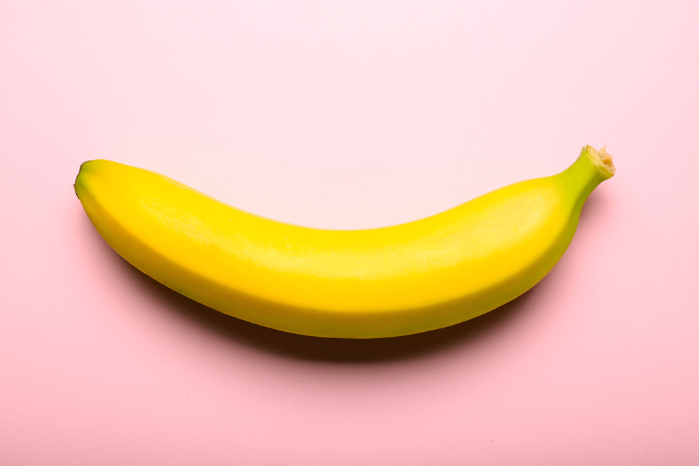 Banana fruit on pink background, close up