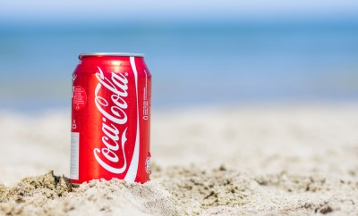 Coca cola can on the beach