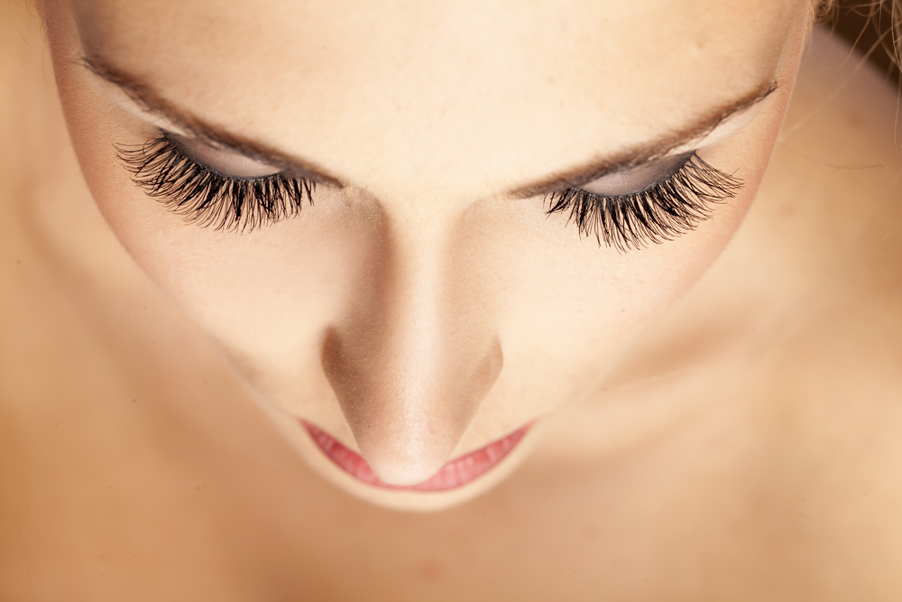 female face and eyes with false eyelashes
