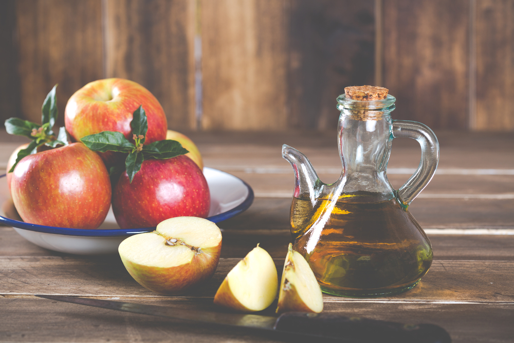 Homemade Vinegar galas apples on a table in a farmhouse