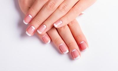 Beautiful moon french manicure. Neat manicure on a white background.