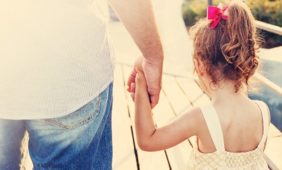 Toned portrait of Father and daughter holding hand in hand at sunset