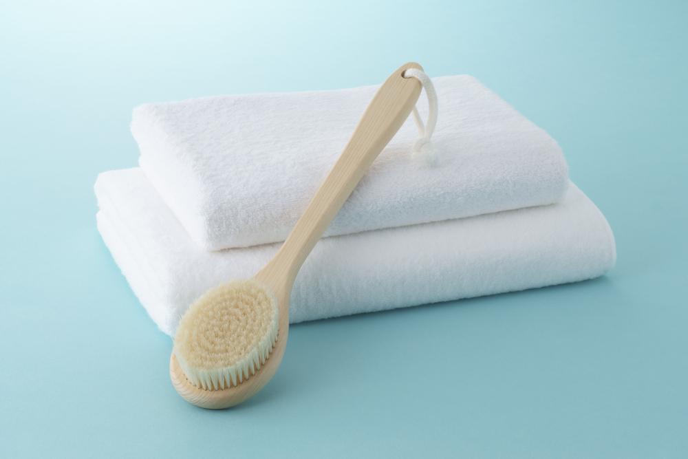 body brush on white towels