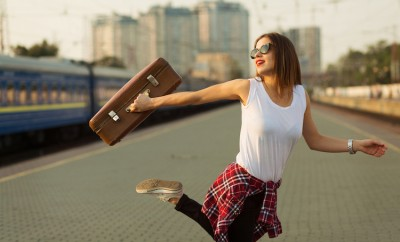 woman, fashion, outdoor, flannel, style, street, jumping, shirt, bohemian, sunglasses, travel, brown, wondering, walking, accessories, smiling, train, jeans, girl, suitcase, watch, waiting, hair, dancing, station, running, pretty, destination, in, urban, caucasian, passengers, sneakers, traveler, excited, young, retro, holding, standing, city, thinking, voyage, moving, railway, migration, looking, trip, track, beautiful, journey, action, happy