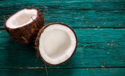 Coconut on wooden table.Organic healthy food concept.Beauty and SPA concept
