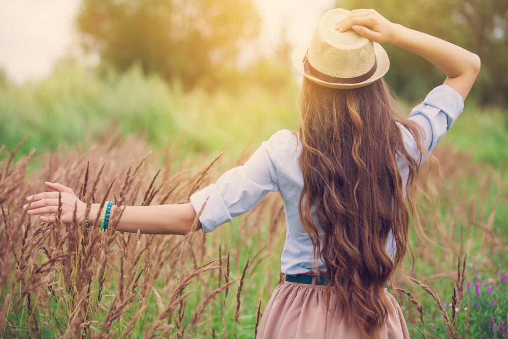 Beauty young girl outdoors enjoying nature