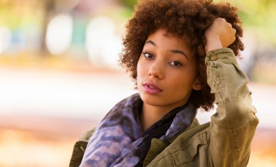 Autumn outdoor portrait of beautiful African American young woman