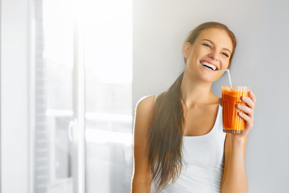 Healthy Lifestyle. Closeup Of Beautiful Smiling Vegetarian Woman Drinking Fresh Raw Detox Vegetable Juice. Healthy Food Eating, Diet And Lifestyle Concept. Drinks. Beauty Concept