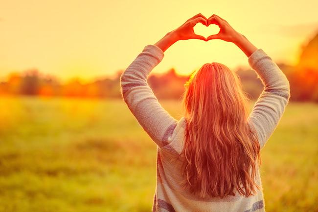 female-making-symbol-for-loving-the-season