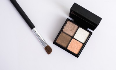 Eye shadow with brush on white background