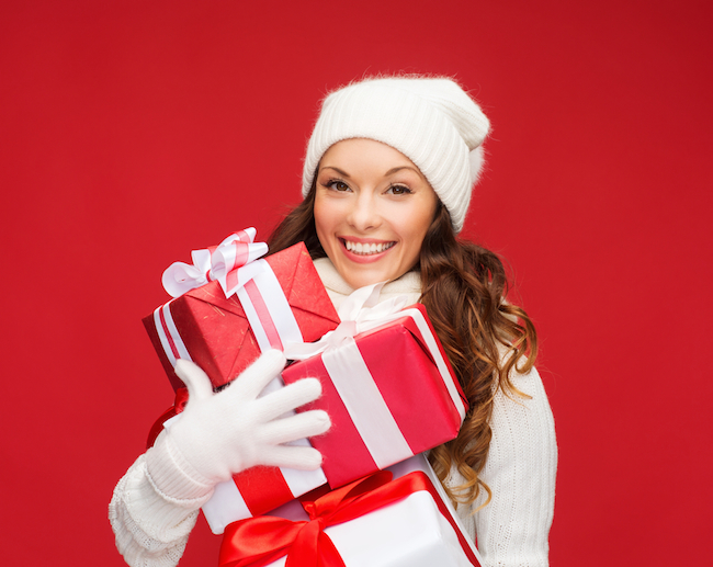 christmas-x-mas-winter-happiness-concept-smiling-woman-in-sweater-and-hat-with-many-gift-boxes