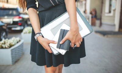 Beautiful Business Girl in the City with Documents