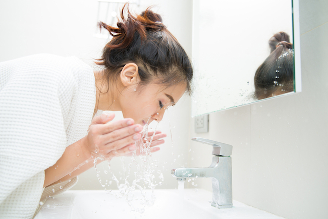 woman-wakes-from-sleep-and-she-was-cleansing-the-morning-before-shower