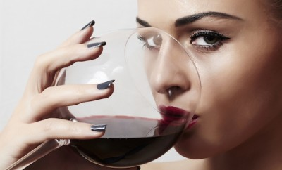 Beautiful blond woman drinking red wine.make-up.red lips.wineglass