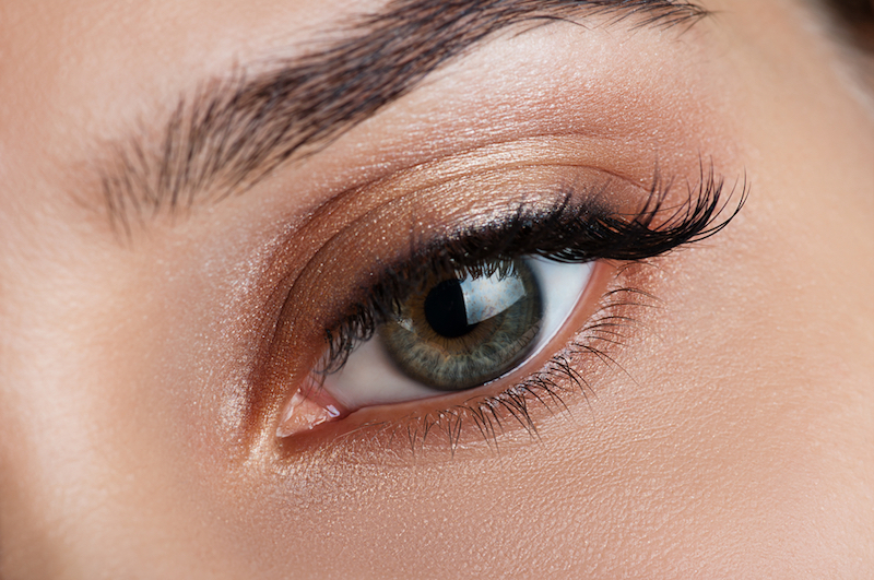 Beautiful bronze eye makeup closeup
