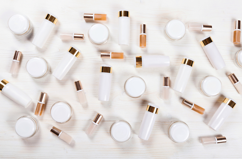 Blank cosmetic tubes on white background. White and gold colors. Place for your text.