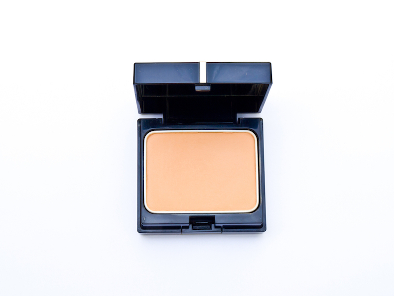 Face powder in a black box isolated in white background