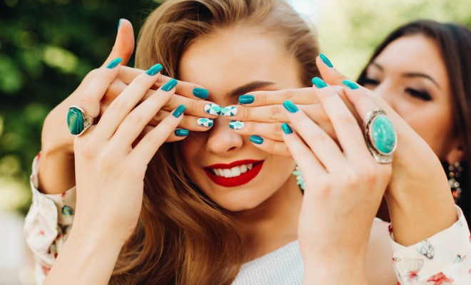 One sister closes her eyes another bright beautiful nail Polish