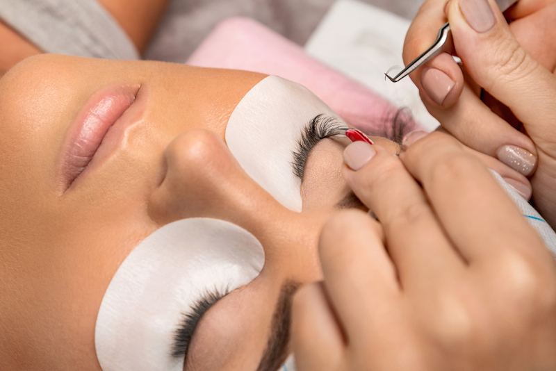 Procedure of eyelashes extension in salon, eyelash extensions