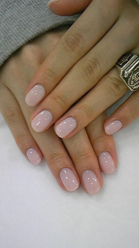 nude nails with statement ring