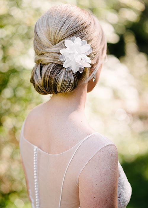 Sleek fold-over bun with flower