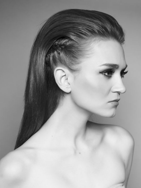 Slicked-back hair with braid