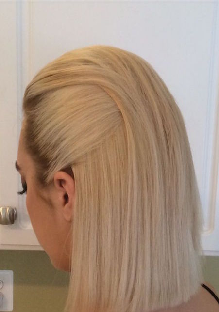 Slicked-back look with roots