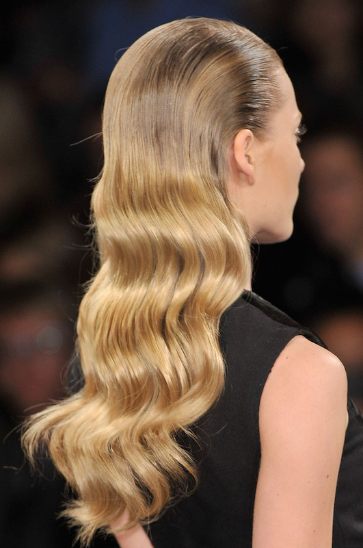 Slicked-back hair with waves